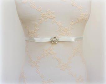 Ivory bow belt. Elastic waist belt. Silver rhinestone flower belt. Dress belt. Bridal belt. Thin belt. Bridesmaids belt. Skinny stretch belt