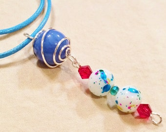 Silver Wire Caged Marble Pendant Necklace With Blue Cord