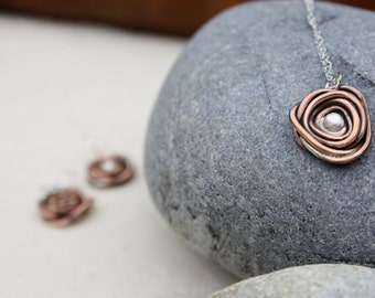 Copper and Silver Nest Necklace.Sterling Silver Center bead. Nest Pendant. Satin finish. Oxidized. warm color metal. mixed metal.