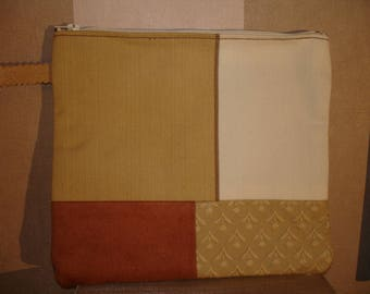 Large pouch in shades of beige, blue, ecru