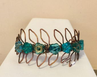 Wire wrapped petal bracelet with teal/aqua flower beads