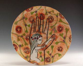 Original Painted Plate - Painting by Jenny Mendes on a round ceramic plate - Nude in Hand