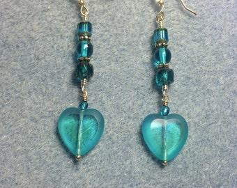 Turquoise Czech glass heart bead dangle earrings adorned with turquoise Czech glass beads.