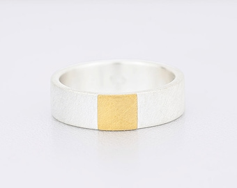 Silver ring with fine gold square