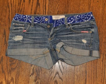 Cut-off shorts with blue handkerchief and silver bead design