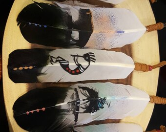 Handed painted Eagle Feathers (imitation) with various Native American designs.