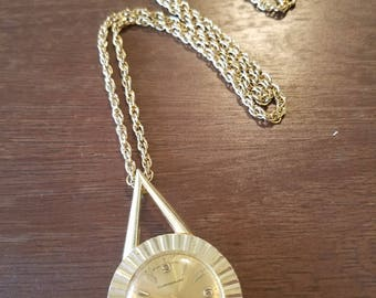Vintage Webster Antimagnetic Gold tone Swiss made movement, watch Pendant on 24 inch vntg chain