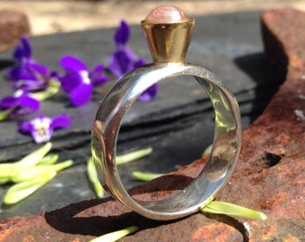 British Handmade silver shaped ring with an 18ct gold tulip setting and natural raw pink diamond.