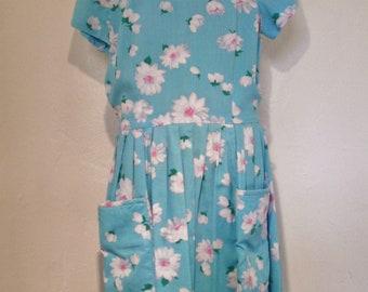 1950s turquoise daisy print dress
