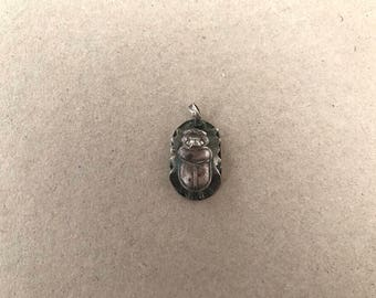 Sterling silver Egyptian scarabs.