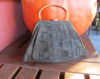 60 leather and braided suede handbag