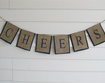 """Rustic Burlap """"CHEERS"""" Wedding, New Years, or Party Banner Shown with Navy Blue Lettering and Outline"""