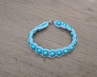 Beautiful bracelet light blue beads and cotton sky blue.