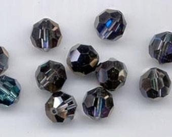 Twelve Swarovski crystals in the effect color crystal bermuda blue - art. 5000 - 10 mm