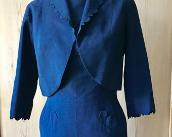 Stunning couture 1950s wiggle suit in navy blue blue.