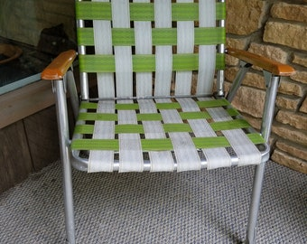 Vintage aluminum folding lawn chair webbed lime green white retro patio wood arm rests