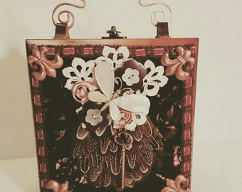 A Steampunk inspired Victorian box purse