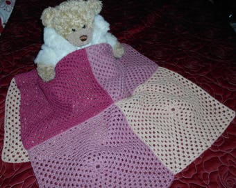 Crochet blanket for baby girls. Pretty pink and apricot squares. Warm and practical. Would make a great gift.