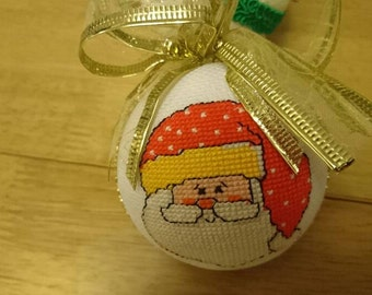 Cross stitch Christmas bauble ready to be hung on