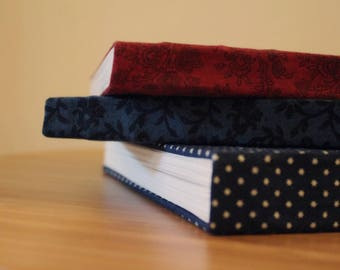 A4 hand bound, fabric bound, paperback sketchbook / journal / scrapbook, made with 140gsm Seawhite cartridge paper, coptic bound