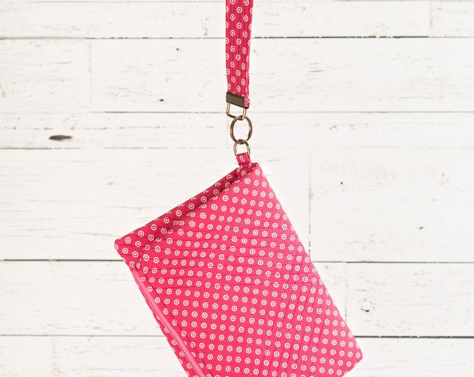 Fold-over clutch with detachable wristlet/key fob
