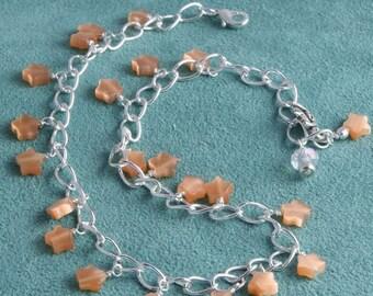 Handmade Dangling Orange Star on Silver Anklet