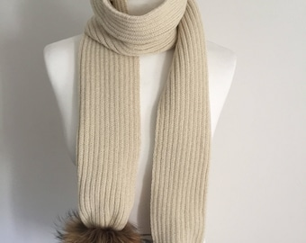 Chunky knitted scarf with detachable fur pom-poms