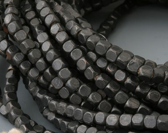 2.8 x 2.5mm Squared Brass Bead Strand With a Flat Black Finish. Square bead strand. Square black beads.