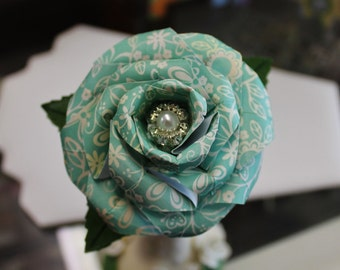 Soft teal paper rose with beaded accent and leaves