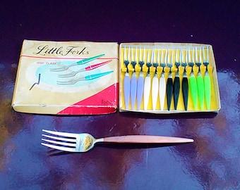 Small vintage snail forks