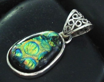 Abstract Fused Dichroic Glass Medallion set in Sterling Silver .925 - Spheres of Irridescent Color -Ornate Scroll Bail at Top