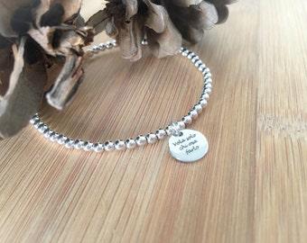 Silver bracelet with pendant engraved laser