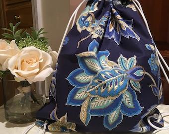 Drawstring Bag (1X) blue bag with cream flower pattern