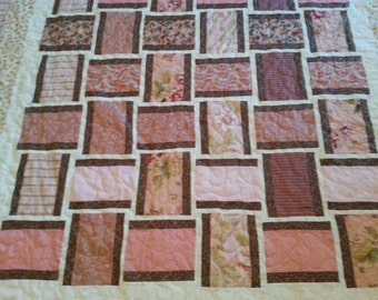 twin size pink and brown quilt