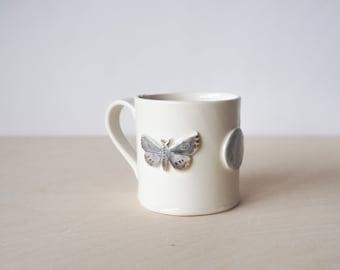 Porcelain mug moths, moon and snake