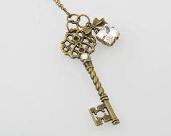 Bronze key necklace Crystal bow
