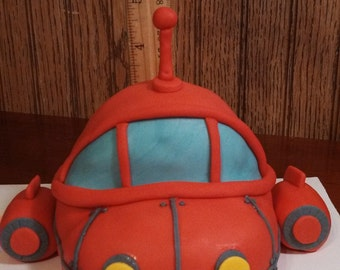 Handmade fondant little red 3-d rocket ship cake topper and accessory kit