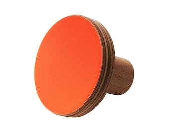 Orange neon drawer knobs in round shape