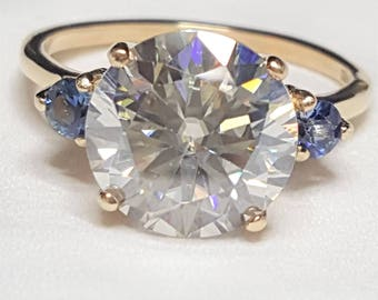 3.46ct Round Moissanite Diamond and .26ctw Blue Sapphire 10kt Yellow Gold Ring