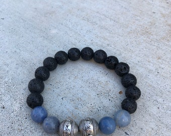 Tourmaline and Lava Beads with Silver Bali bead. Comes with a vial of essential oils.