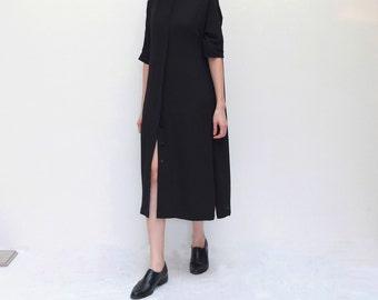 black minimalist shirt dress with mock mandarin collar