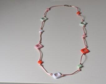 Necklace of plastic parts