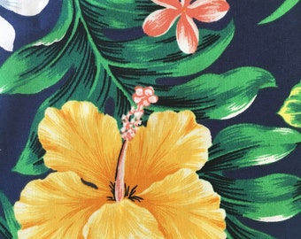 Hawaiian print fabric, tropical print,.Lush tropical flowers and folage on a navy background. Cotton poly . Fat quarter.