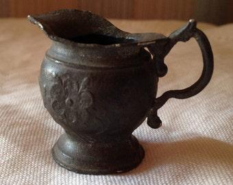Miniature metal pitcher