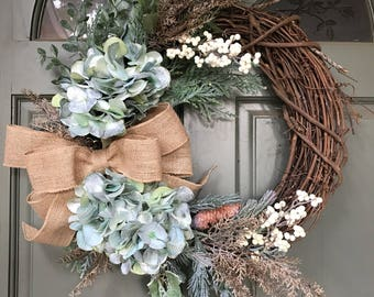 Holiday Christmas Wreath w/ hydrangea and greenery, frosted flowers, pine cones and metallic berries, burlap bow