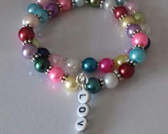 Stretch bead bracelet with love charm