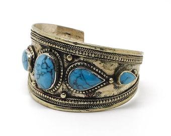 Cuff with inlaid stones bracelet