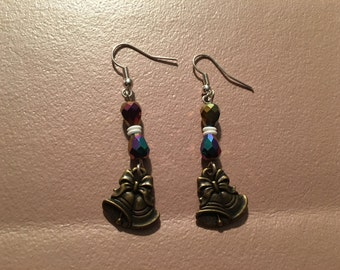 Earrings, dangle, beaded, multicolored and white with gold bell charms on sterling silver hooks.