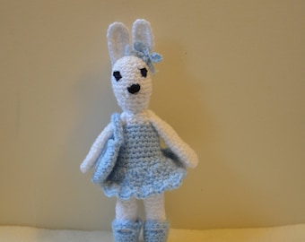 White bunny rabbit, soft toy, amigurumi doll, rabbit in a dress