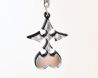 Kingdom Hearts Reflective Nobody Emblem Necklace or Keychain